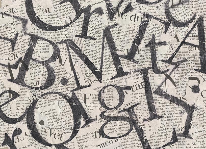 Acetonbuchstaben auf Zeitungsschnipsel